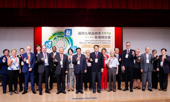 Environmental regulations experts from the United States, Europe, and Asia pose for a group photo at the 2019 International Chemical and Mercury Management Conference in Taipei, Taiwan, on Aug. 7, 2019. (Chen Po-chou/The Epoch Times)
