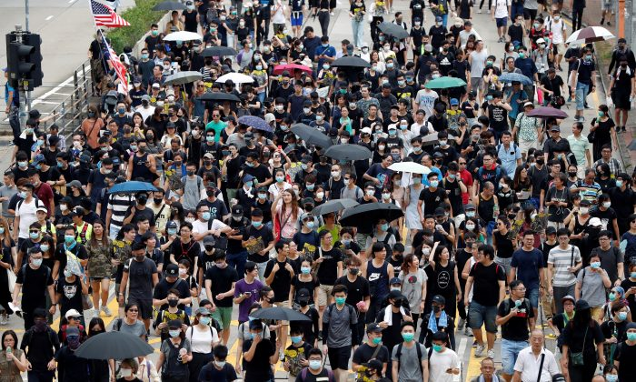 Anti-extradition bill protesters walk through Sham Shui Po neighborhood in Hong Kong, China on Aug. 11, 2019. (Issei Kato/Reuters)