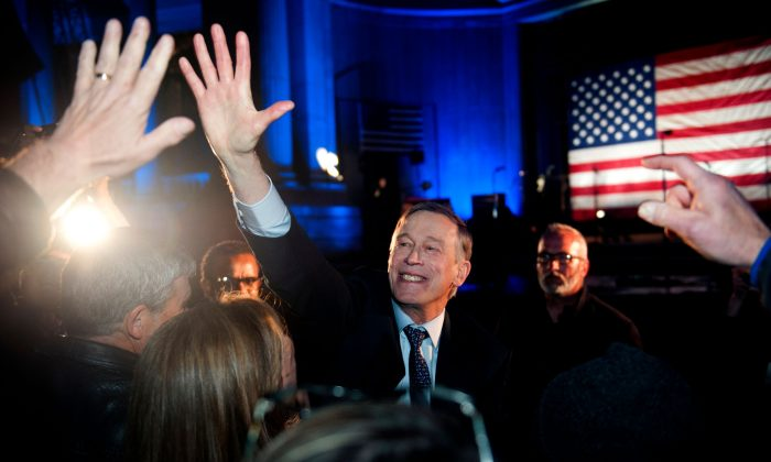 Former Colorado Governor John Hickenlooper greets supporters after his campaign kick-off rally for the 2020 US presidential race at Civic Center Park in Denver, Col. on Mar. 7, 2019. (Jason Connolly/AFP/Getty Images)