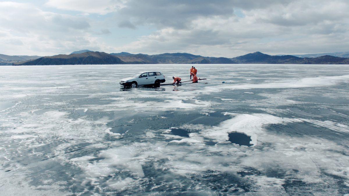 sinking car on frozen lake