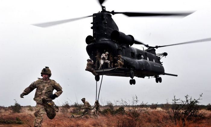 U.S. Army Rangers, 1st Battalion, 75th Ranger Regiment, participate in a Combined Arms Live Fire Exercise (CALFX) near Fort Stewart, Ga., Jan. 10, 2012. (The U.S. Army/Flickr/CC by 2.0 [https://bit.ly/1mhaR6e])