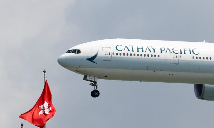 A Cathay Pacific Boeing 777-300ER plane lands at Hong Kong airport after it reopened following clashes between police and protesters, in Hong Kong, China on Aug. 14, 2019. (Thomas Peter/Reuters)