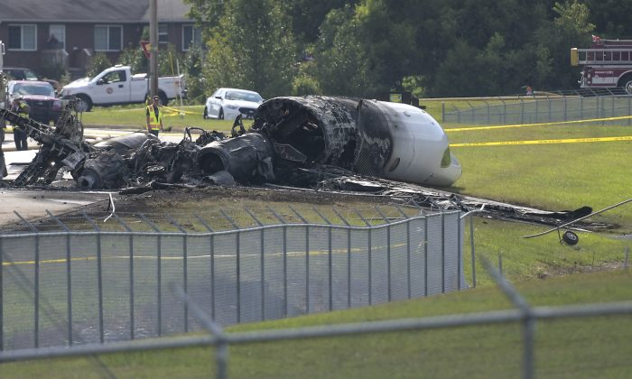 The burned remains of a plane that was carrying NASCAR television analyst and former driver Dale Earnhardt Jr. lie near a runway in Elizabethton, Tenn. on Aug. 15, 2019. (Earl Neikirk/Bristol Herald Courier via AP)