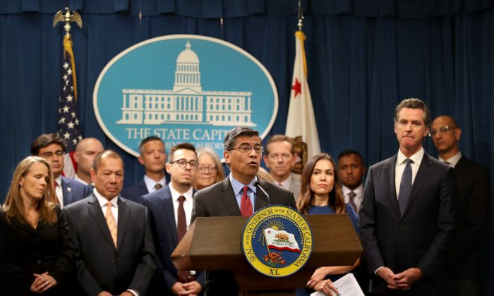 California attorney General Xavier Becerra (C) speaks during a news conference with California Gov. Gavin Newsom (R) at the California State Capitol  in Sacramento, Calif., on Aug. 16, 2019. (Justin Sullivan/Getty Images)
