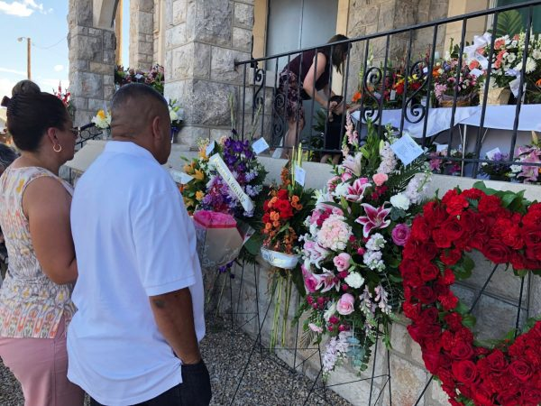 Mourners deliver flowers for Margie Reckard
