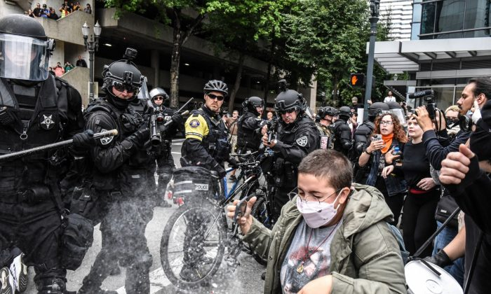 Portland police fire pepper spray rounds into a crowd of protesters during a rally in Portland, Oregon on Aug. 17, 2019. (Stephanie Keith/Getty Images)
