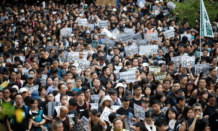 Teachers protest against the extradition bill during a rally organized by Hong Kong Professional Teachers' Union in Hong Kong, on Aug. 17, 2019. (Kim Hong-Ji/Reuters)