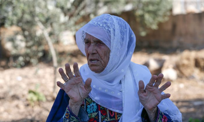 Muftia Tlaib, the maternal grandmother of Rep. Rashida Tlaib (D-Mich.), is pictured outside her home in the village of Beit Ur al-Fauqa, in the occupied West Bank on Aug. 15, 2019. (Abbas Momani/AFP/Getty Images)
