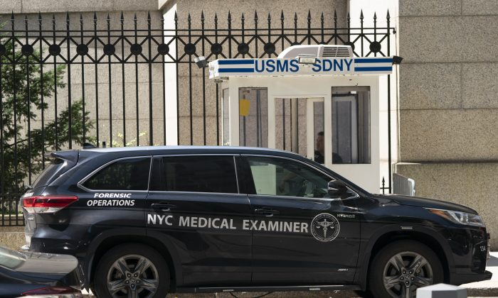 A New York Medical Examiner's car is parked outside the Metropolitan Correctional Center where financier Jeffrey Epstein was being held, on Aug. 10, 2019, in New York. (DON EMMERT/AFP/Getty Images)