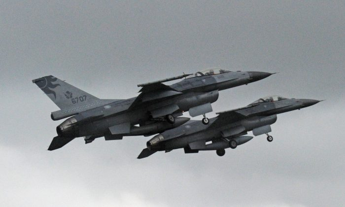 Two US-made F-16 fighters in the air during an scramble take off at the eastern Hualien air force base on Jan. 23, 2013.  (Sam Yeh/AFP/Getty Images)