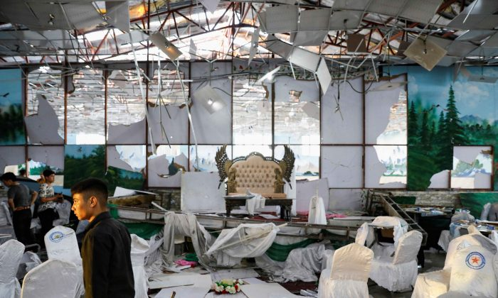 Workers of a wedding hall inspect after a blast in Kabul, Afghanistan, on Aug. 18, 2019. (REUTERS/Mohammad Ismail)