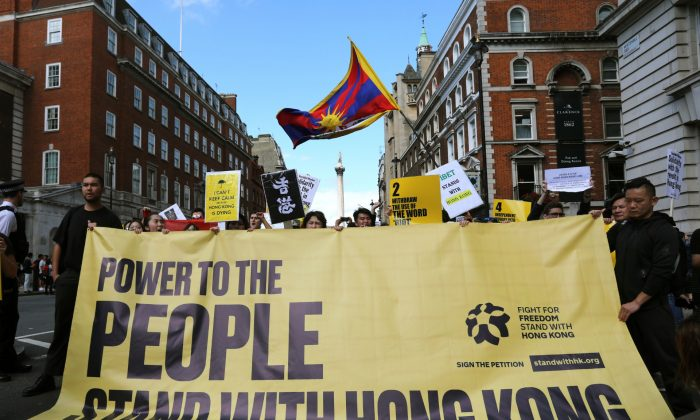 Protesters gather in central London to attend a march organized by StandwithHK and D4HK in support of pro-democracy protests in Hong Kong on Aug. 17, 2019. (Isabel Infantes/AFP/Getty Images)