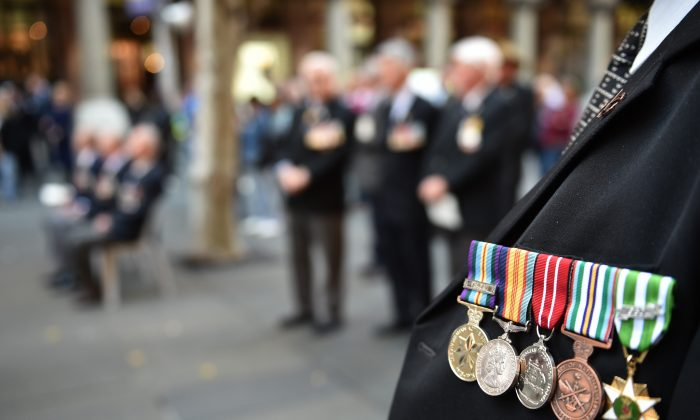 An Australian war veteran wears his medals, including a service medal from the Vietnam war (Far-L), at the 50th anniversary of the Vietnam Veterans Memorial Service in Sydney on Aug. 18, 2016. (PETER PARKS/AFP/Getty Images)