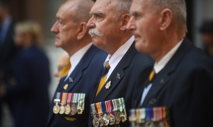 Australian war veterans wear their medals at the 50th anniversary of the Vietnam Veterans Memorial Service in Sydney on Aug. 18, 2016. (PETER PARKS/AFP/Getty Images)