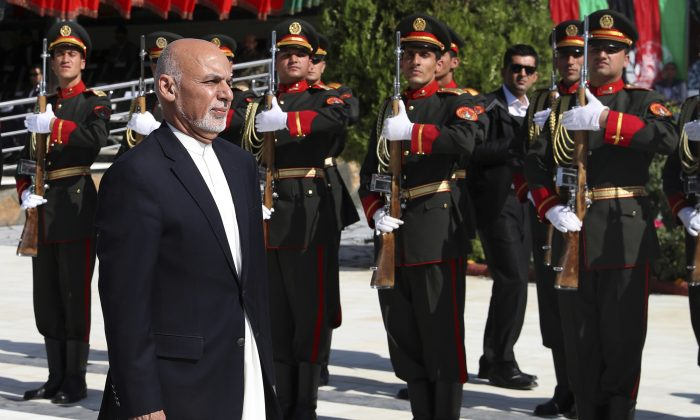 Afghan President Ashraf Ghani inspects the honor guard during Independence Day celebrations at Defense Ministry in Kabul, Afghanistan on Aug. 19, 2019. (Afghan Presidential Palace via AP)