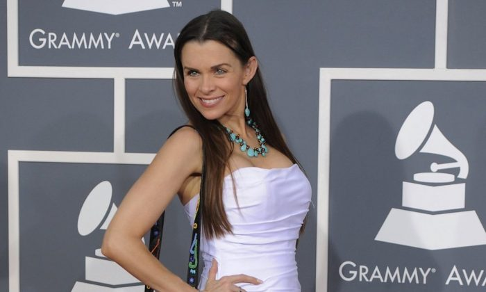 Alicia Arden arrives on the red carpet at the 54th annual Grammy Awards in Los Angeles, on Feb. 12, 2012. (AP Photo/Chris Pizzello, File)
