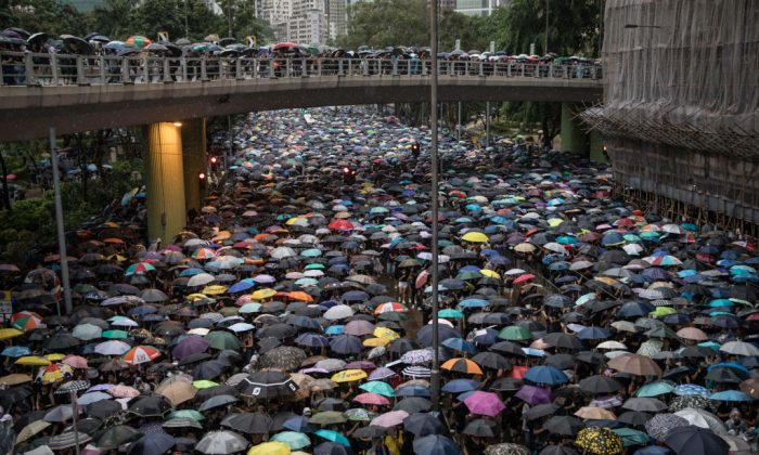 Hundreds of thousands of protesters march on a street after leaving a rally in Victoria Park in Hong Kong on Aug. 18, 2019. (Chris McGrath/Getty Images)