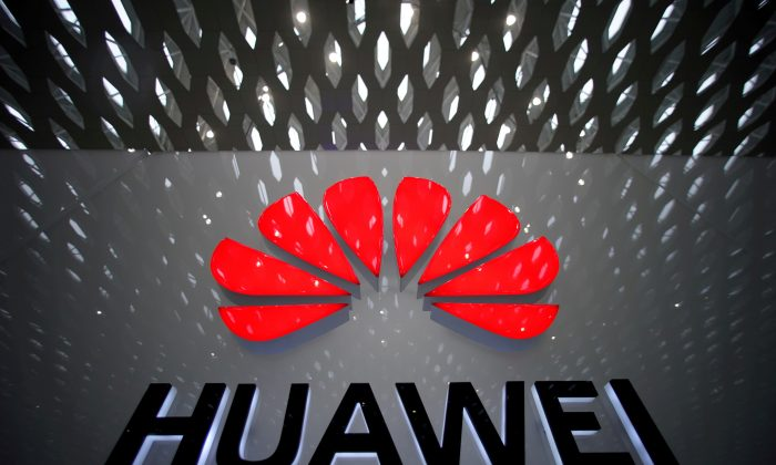 A Huawei company logo is pictured at the Shenzhen International Airport in Shenzhen, Guangdong Province, China on July 22, 2019. (Aly Song/Reuters)
