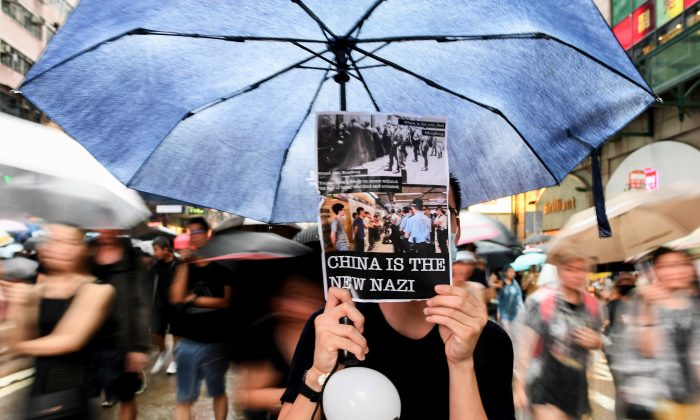 Protesters march during a rally in Hong Kong on Aug. 18, 2019, in the latest opposition to a planned extradition law that has transformed into a wider call for democratic rights. (Manan Vatsyana/AFP/Getty Images)