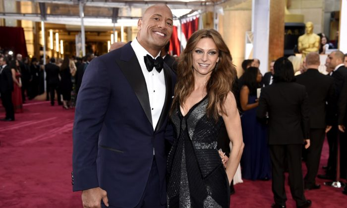 Dwayne Johnson (L) and Lauren Hashian arrive at the Oscars at the Dolby Theatre in Los Angeles on Feb. 22, 2015. (Chris Pizzello/Invision/AP)