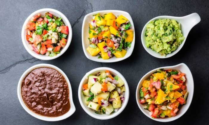 Traditional famous Mexican sauces to try: chocolate chili mole poblano, pico de gallo, avocado guacamole, salsa bandera, pinapple salsa, and mango salsa. (Larisa Blinova/Shuttertock)