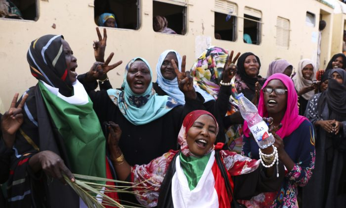Sudanese pro-democracy supporters celebrate a final power-sharing agreement with the ruling military council, in Khartoum, Sudan, on Aug. 17, 2019. (AP)