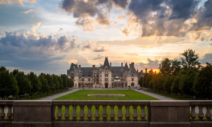 A view of the sunrise behind the Biltmore Estate. (Jared Kay/ExploreAsheville.com)