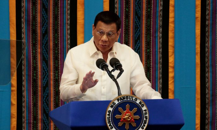 Philippine President Rodrigo Duterte gestures during his fourth State of the Nation Address at the Philippine Congress in Quezon City, Metro Manila, Philippines on July 22, 2019. (Eloisa Lopez/Reuters)