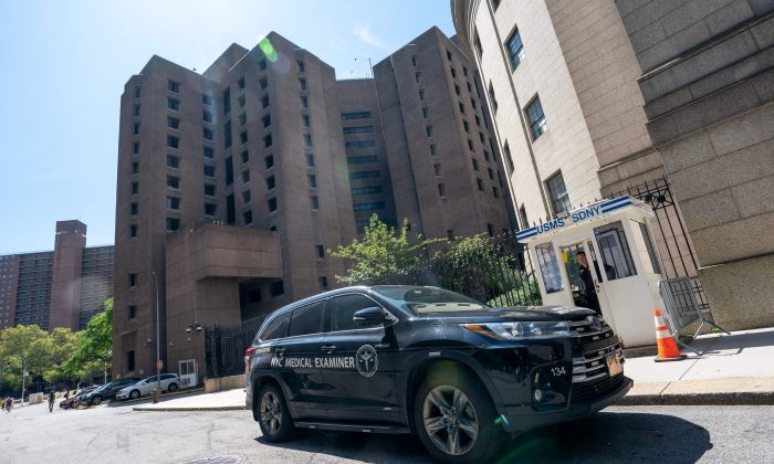 A New York Medical Examiner's car is parked outside the Metropolitan Correctional Center where financier Jeffrey Epstein was held at in New York City on Aug. 10, 2019. (Don Emmert/AFP/Getty Images)