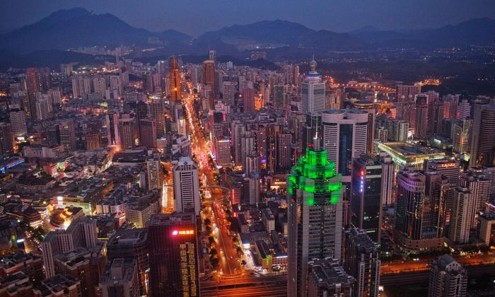 The Shenzhen skyline on Nov. 28, 2010. The building illuminated by green lights is the Shenzhen World Financial Center. (Daniel Berehulak/Getty Images)