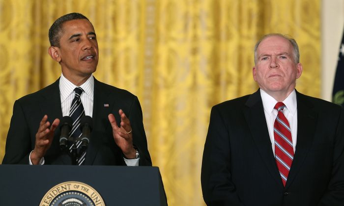 Then-President Barack Obama (L) nominates chief counterterrorism adviser John Brennan (R), to be CIA Director during an event in the East Room at the White House on Jan. 7, 2013. (Mark Wilson/Getty Images)