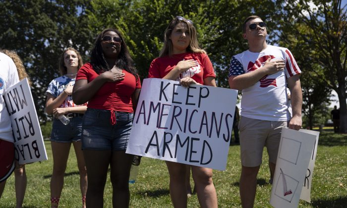People sing the national anthem during the March For Our Rights rally, promoting Second Amendment Rights and the safety of students in schools, outside the U.S. Capitol in Washington on July 7, 2018. (Toya Sarno Jordan/Getty Images)