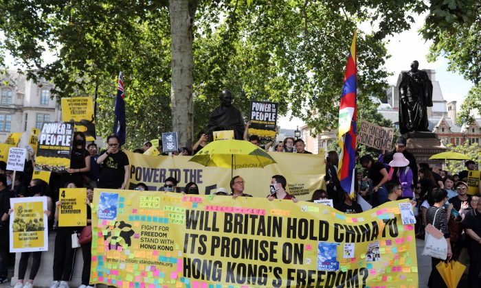 Protesters hold up placards as they gather in central London to attend a march organized by StandwithHK and D4HK  in support of pro-democracy protests in Hong Kong, on Aug. 17, 2019. (Isabel Infantes/AFP/Getty Images)