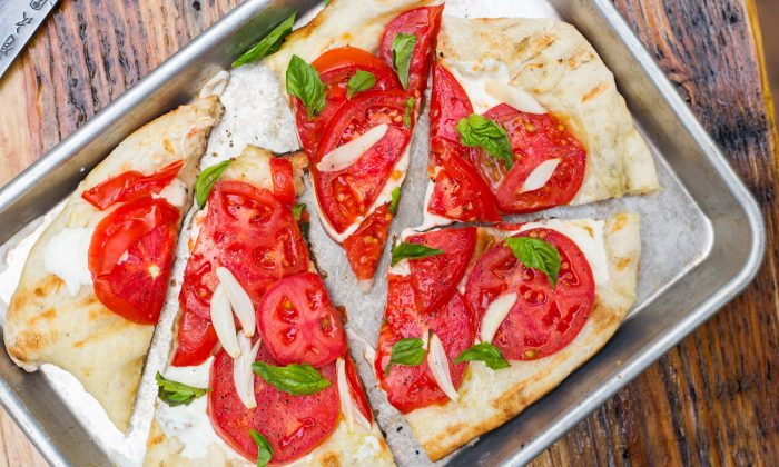 Pizza, hot off the grill.  (Caroline Chambers)