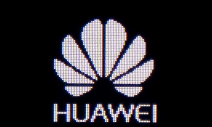 The Huawei logo appears on a Huawei portable wifi device in Beijing on June 29, 2019. (Nicolas Asfouri/AFP/Getty Images)