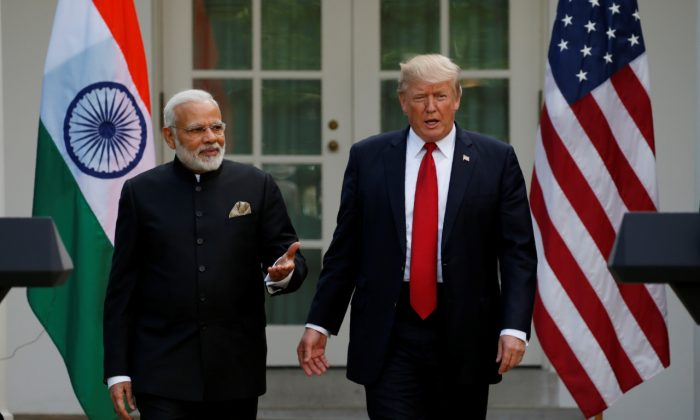 President Donald Trump (R) arrives for a joint news conference with Indian Prime Minister Narendra Modi in the Rose Garden of the White House in Washington, on June 26, 2017. (Kevin Lamarque/Reuters)