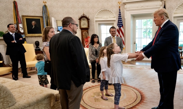 President Donald Trump meets with meme makers known as Carpe Donktum and Mad Liberals at the Oval Office in the White House in Washington on July 3, 2019. (White House)