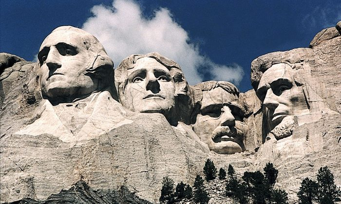 This June 1995 photo shows Mt. Rushmore, in Keystone, South Dakota. Sculptor Gutzon Borglum started work on Mt. Rushmore Aug. 10, 1927, and continued for 14 years, but only 6.5 years were actually spent sculpting due to harsh weather delays. The presidents were selected on the basis of what each symbolized. George Washington (L) represents the struggle for independence; Thomas Jefferson (2nd L), the idea of government by the people; Theodore Roosevelt (2nd R), for the 20th century role of the United States in world affairs; and Abraham Lincoln (R) for his ideas on equality and the permanent union of the states. (Karen Bleier/AFP/Getty Images)