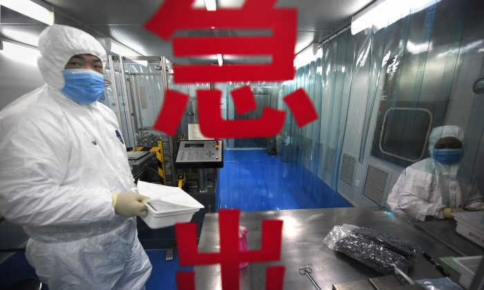 Lab technicians work at Chinese firm Sinovac Biotech in Beijing on Aug. 24, 2009. (Peter Parks/AFP/Getty Images)
