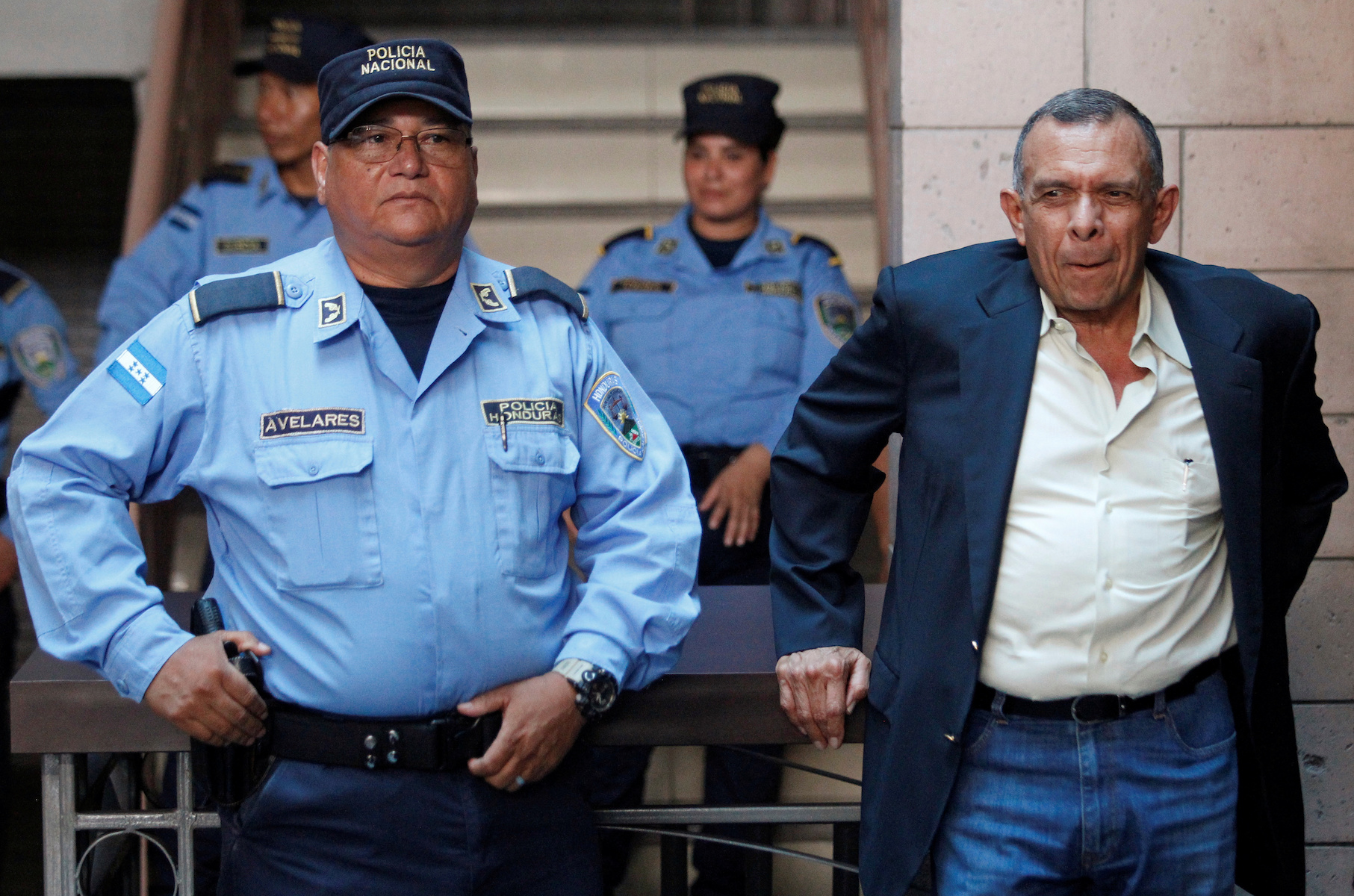 Former Honduras' President Porfirio Lobo waits outside a court where his wife Rosa Elena Bonilla is appearing to face graft charges, in Tegucigalpa