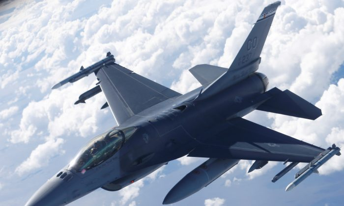 A U.S. Air Force F-16 fighter taking part in the U.S.-led Saber Strike exercise flies over Estonia June 6, 2018. (Ints Kalnins/Reuters)