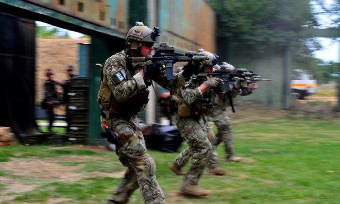 U.S. Soldiers with 10th Special Forces Group participate in small arms training at Szolnok Air Base, Hungary, on July 13, 2012.  (U.S. Air Force photo by Staff Sgt. Tyler Placie/Released/CC BY 2.0)