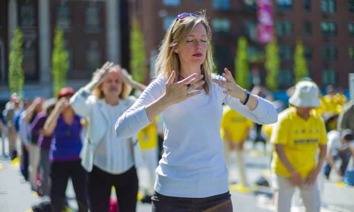 Falun Gong practitioners exercise at Union Square in New York as they celebrate World Falun Dafa Day on May 12, 2016. (The Epoch Times)