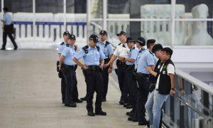 Hong Kong Police Officers Arrested for Torturing Elderly Man