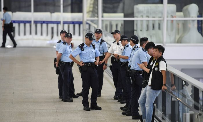 Policemen patrol inside the Hong Kong international airport on August 19, 2019. (GREG BAKER/AFP/Getty Images)