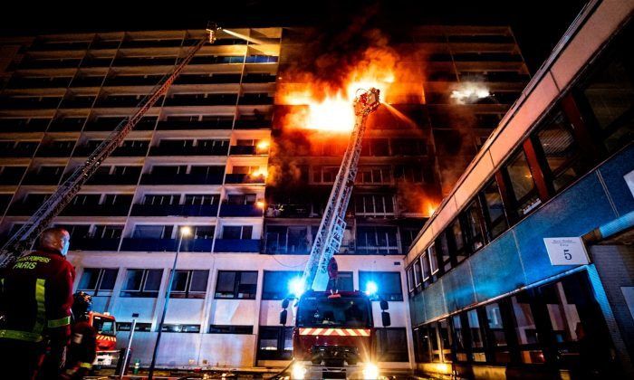 Fire burns in the Henri Mondor hospital complex in Creteil, on the outskirts of Paris, France on Aug. 22, 2019, in this still image taken from a social media video. (Limam Alistair via Reuters)