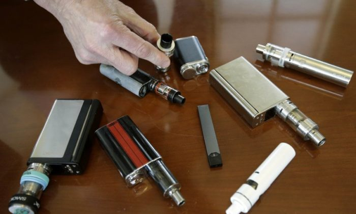 Vaping devices in a file photograph. (AP Photo/Steven Senne)