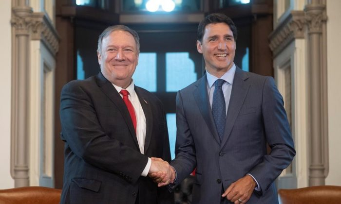 Canadian Prime Minister Justin Trudeau meets with US Secretary of State Mike Pompeo on Parliament Hill in Ottawa, August 22, 2019. (Adrian Wyld/The Canadian Press)