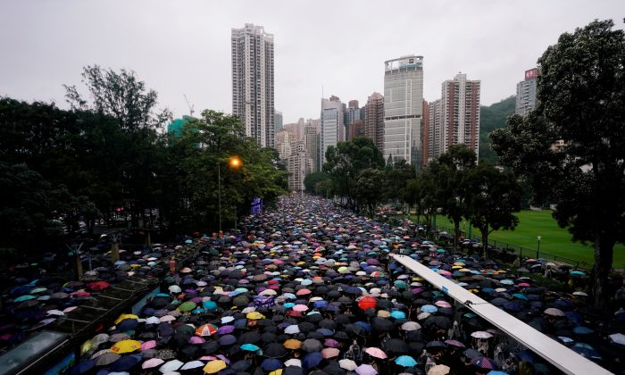 Anti-extradition bill protesters march to demand democracy and political reforms in Hong Kong, China on Aug. 18, 2019. (Aly Song/Reuters)