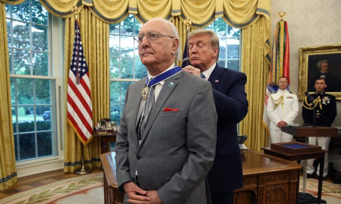 President Donald Trump presents the Medal of Freedom to retired Boston Celtic Bob Cousy in the Oval Office at the White House on Aug. 22, 2019. (Mark Wilson/Getty Images)